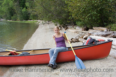 Young woman in a canoe holding the paddle - Clearwater Lake, Wells Gray Provincial Park, British Columbia, Canada
