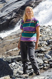 mature woman at bow glacier falls in the canadian rockies - banff national park, canada - adobe RGB