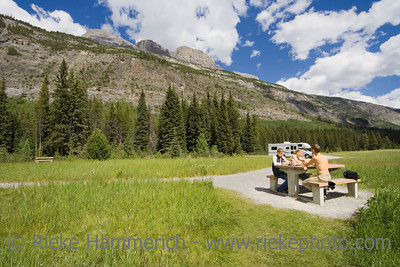 father and kids having a picnic - rocky mountains, canada - adobe RGB