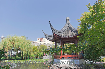 Vancouver, British Columbia, Canada – August 6, 2005: View of Dr. Sun Yat-Sen Classical Chinese Garden with Pagoda in Vancouver, Canada. Dr. Sun Yat-Sen Classical Chinese Garden was built using the principles and techniques of the original Ming Dynasty Garden and opened 1986. The design is based on the harmony of the four main elements rock, water, plants, and architecture. They combine to create an experience of perfect balance.