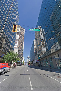 Vancouver, British Columbia, Canada – August 5, 2005: View from Robson Street into Seymour Street in Vancouver, Canada. On the left is the Scotia Tower, and in the background is the Lookout Tower of Harbour Centre in downtown Vancouver.
