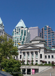 Vancouver, British Columbia, Canada – August 5, 2005: Vancouver Art Gallery in front of Cathedral Place in Vancouver, Canada. The Vancouver Art Gallery is a neoclassical Building, was designed by Francis Rattenbury, built 1906 and is the largest art gallery in Western Canada.