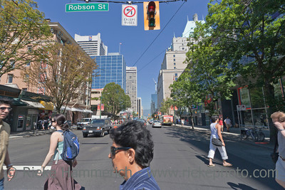 Vancouver, British Columbia, Canada – August 5, 2005: Street Scene on Burrard Street with the Royal Bank Tower on the left and the Fairmont Hotel Vancouver on the right in Vancouver, Canada. Burrard Street is a major thoroughfare and the central street of Downtown Vancouver and the Financial District.