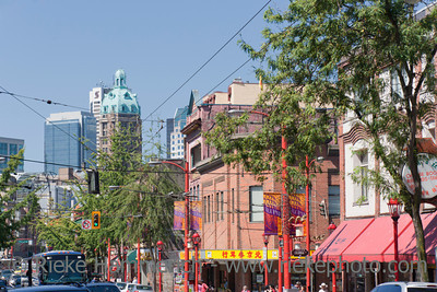 Vancouver, British Columbia, Canada – August 6, 2005: Street Scene with Stores and Traffic in Pender Street in Chinatown of Vancouver, Canada. Chinatown in Vancouver is one of the largest historic Chinatowns in North America and a popular tourist attraction.