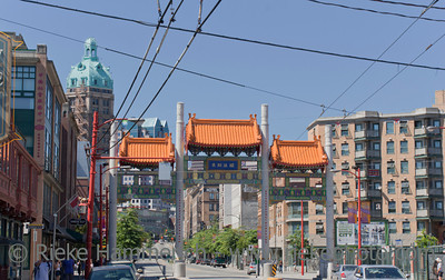 Vancouver, British Columbia, Canada – August 6, 2005: Vancouver Chinatown Millenium Gate on East Pender Street in Vancouver, Canada. The Gate was donated to the City of Vancouver by the Government of the People's Republic of China following the Expo 1986 world's fair, where it was on display. After being displayed for almost 20 years at its current location, the Gate was re-built and received a major renovated facade employing stone and steel.