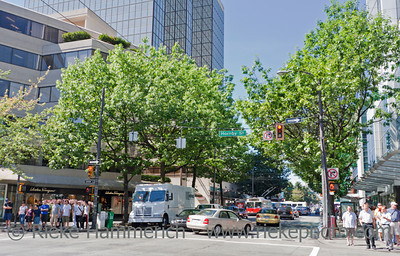 Vancouver, British Columbia, Canada – August 5, 2005: Street Scene on Robson Street between Hornby and Burrard Street in Vancouver, Canada. Robson is Vancouver's most famous shopping street set in the heart of downtown Vancouver.