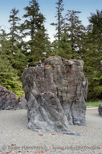 Lonely Teenage Boy on Top of a big Rock - Pacific Rim National Park, Vancouver Island, British Columbia, Canada