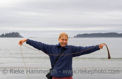 Young Woman having fun with Pom-Pom Kelp – Long Beach, Pacific Rim National Park, Vancouver Island, British Columbia, Canada