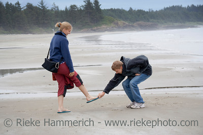 Teenage Boy stealing Flip-Flop of his Sister - Long Beach, Pacific Rim National Park, Vancouver Island, British Columbia, Canada