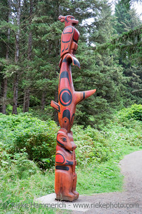 Totem Pole in the Woods - Pacific Rim National Park, Vancouver Island, British Columbia, Canada - Totem Pole of the Ucluelet First Nation on the South Beach Trail with a thunderbird, killer whale, bear and a salmon