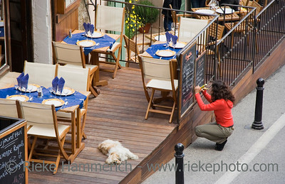 restaurant in ramatuelle on the french riviera - with a young woman writing the menu of the day on a blackboard - adobe RGB