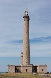 Barfleur, France - July 1, 2011: View of the Phare de Gatteville in Barfleur, France. This granite lighthouse is at a height of 75 m (247 feet) the third tallest in the world and was built 1774.