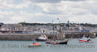 SAINT-MALO, FRANCE - JULY 6: Sailship 'Etoile de France' and other ships anchored in the Port of Saint-Malo, France on July 6, 2011. Cross-channel cargo has significantly increased.