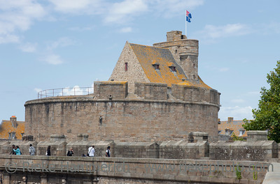 SAINT-MALO, FRANCE - JULY 6: Medieval castle built in 14th century with tourists in the old town of Saint-Malo, France on July 6, 2011. Saint-Malo is the main tourist attraction of Brittany in France.