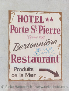 SAINT-MALO, FRANCE - JULY 6: Vintage billboard of Hotel Porte St. Pierre in Saint-Malo, France on July 6, 2011. The hotel is located in the heart of the historic town.