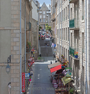 SAINT-MALO, FRANCE - JULY 6: High angle view of an alley with restaurants and shops in Saint-Malo, France on July 6, 2011. Today Saint-Malo is the main tourist attraction of Brittany in France.