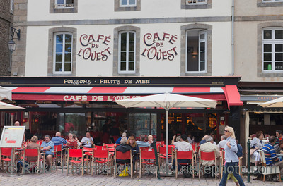 SAINT-MALO, FRANCE - JULY 6: Cafe de l'Ouest in Saint-Malo, France on July 6, 2011. The cafe is located on the Place Chateaubriand and famous for their seafood.