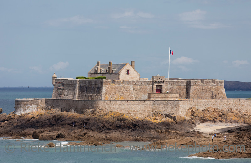 SAINT-MALO, FRANCE - JULY 6: Fort with tourists on tidal island Petit Be in Saint-Malo, France on July 6, 2011. The fort was built in 17th century. It was part of the defense belt designed by Vauban.
