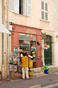 saleswoman in front of her shop - small trade in saint-tropez, france - adobe RGB