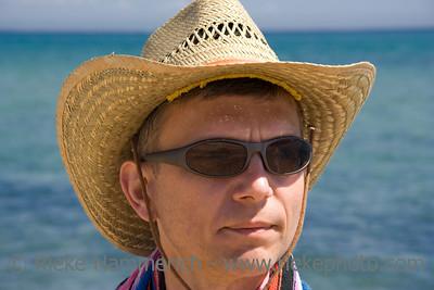 summer portrait - mid adult man with sunhat on the beach - adobe RGB