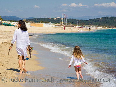 mother and daughter walking at the beach - saint-tropez, french riviera - adobe RGB