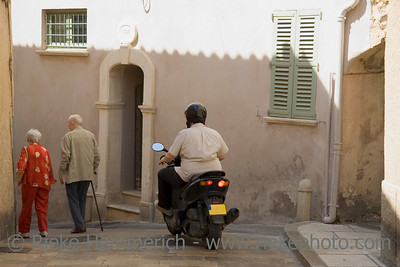 senior couple fit as a fiddle and an overweight motorcyclist - in the streets of  saint-tropez, france - adobe RGB