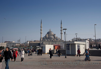 Busy People at Eminonu Square in Istanbul with Yeni Cami Mosque in the Background - Istanbul, Turkey, Europe