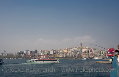 Cityscape of Istanbul with Anglers - View from Galata Bridge to Old Town around Galata Tower