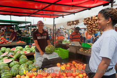SAN JOSE, COSTA RICA - AUGUST 31: Young woman shopping on farmer's market in San Jose, Costa Rica on August 31, 2008. Farmer's markets are a traditional way of selling agricultural products.