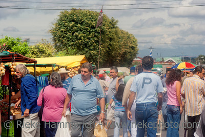 San Jose, Costa Rica - August 31, 2008: People shopping on the farmer's market in San Jose, Costa Rica. Farmers markets are a traditional way of selling agricultural and home manufactured products in Latin America.