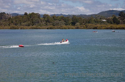 Children in Dinghy pulled by Motorboat - Whananaki Estuary, Northland, North Island, New Zealand