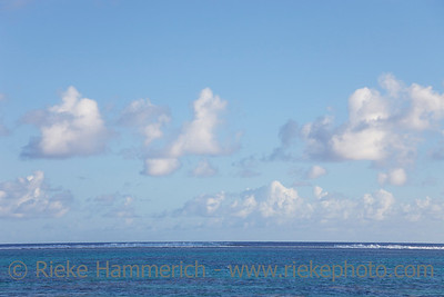Cumulus Clouds over Tropical Lagoon in the South Pacific Ocean