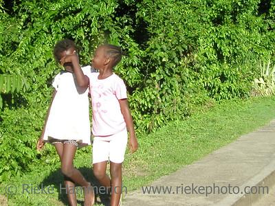 two happy caribbean girls - tobago, west indies