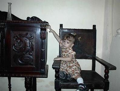 My Granmother Rosa Acevedo Batista's home in La Habana, Cuba - Known today as Casa de Rosa e Irene Calle Cardenas#103 Photograph in 2002. Young Thalia reaching up.