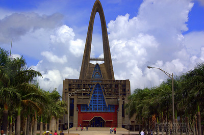 The Basilica is at the end of a private road surrounded by palm tress planted symmetrically.