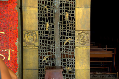 The entry is bronze coated with 24k gold and blessed in Rome.