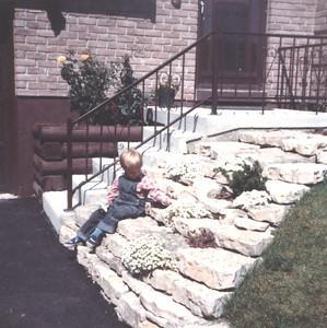 Ian sitting on rock garden