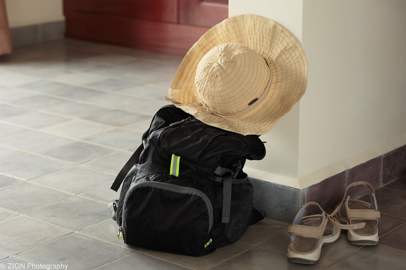 Backpack, hat, and sandals.