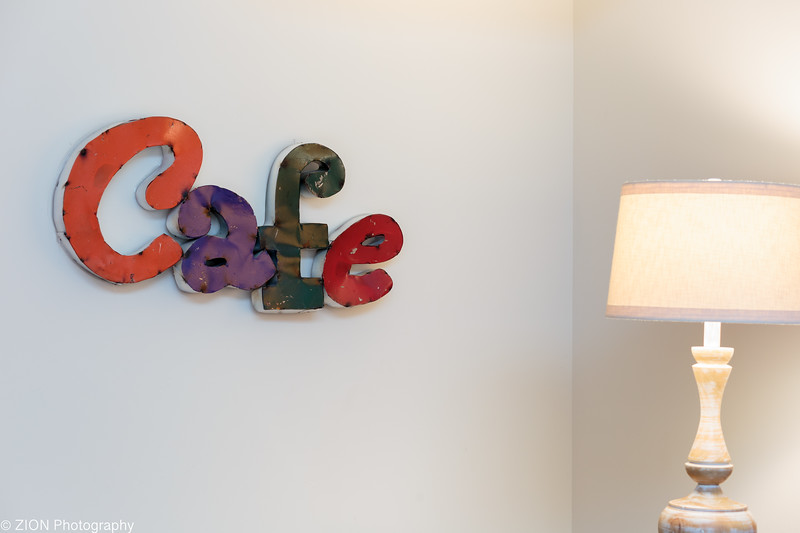A cafe sign inside a home.