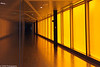 A look at the yellow lighted panel hallway at an art school in Chicago