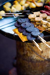 "Lijiang is views, food, food, nice people, food...did I say food? Here a few ""snacks"" on the side of the street"