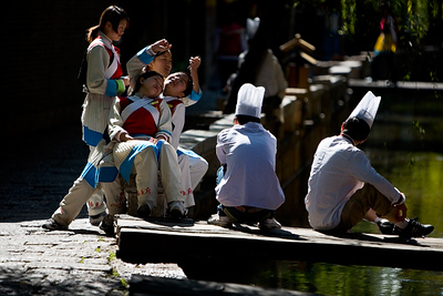 Naaxi young ladies and chef's having a rest before the dinner peparations start. People in Lijiang have a quite relaxed attitude to life.