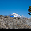 The Jade dragon Snow mountain as seen above one Lijiang roof top (with the China Construction bank logo nicely placed in the way..)