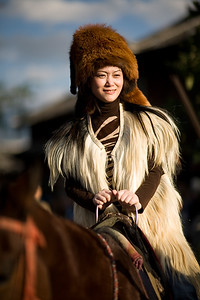 """Young """"wanna be horse back minority lady"""" but she was actually a tourist paying a few cents to get on the horse and take a few pictures"""