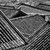 "Is this the ""must have"" picture of Lijiang roof tops? Instead of showing the traditional picture of all the roof tops seen from a hill, i tried to get closer and show the details by making it B&W"