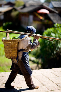Lady on her way back home after a long day on the fileds outside Suhe