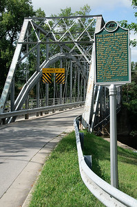 The Currie Parkway Bridge is an eight panel pin-connected truss bridge built in 1908.