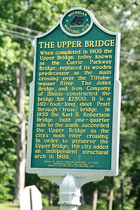 Sign in front of the Currie Parkway Bridge explains its history.