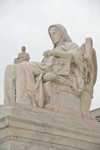 The Contemplation of Justice statue on the front steps of the US Supreme Court building.