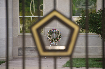 Looking at the outside of the memorial chapel through the Pentagon Memorial fence.